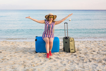 Freedom, travel, vacation and summer concept - Traveler woman with suitcases and laughs