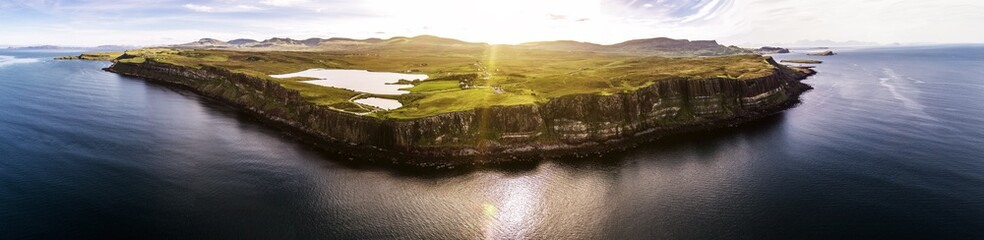 Cinematic aerial shot of the dramatic coastline at the cliffs close to the famous Kilt Rock waterfall ,Skye