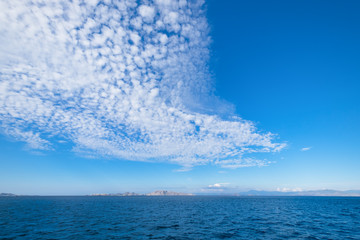 Panoramic blue sky background with white clouds on a sunny day over the sea in flores island, Labuan bajo, Indonesia