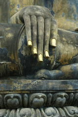 hand of statue of buddha,in the historical park of Sukhothai,Thailand