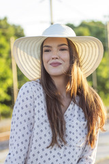 Portrait of young beautiful girl with hat on her head