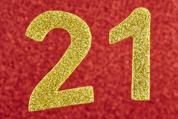 Number twenty-one golden over a red background. Anniversary.