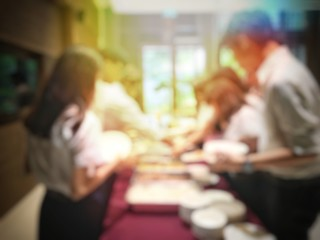 Abstract blur image of Lunch break education people and student in line wait for food meals. vintage tone colour  .Indoor catering food party concept.