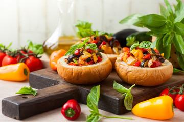 Eggplant caponata in bread bowls