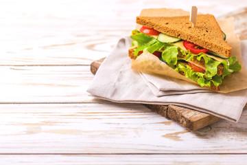 Rye bread sandwich with ham, cheese, lettuce