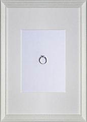 ring on white wood picture frame