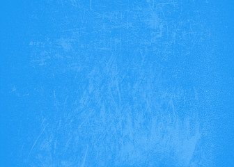 Blue bright abstract background texture with scratches and splashes of paint