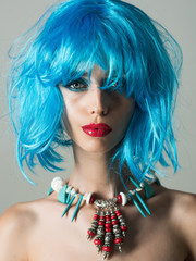 woman with blue hair wig and fashionable makeup
