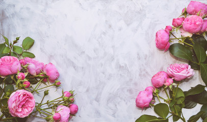 Pink roses on white shabby chic background with blank space. Vintage mockup for design