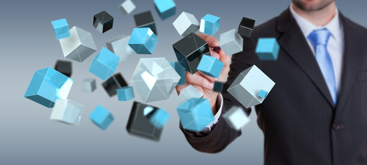 Businessman holding floating blue shiny cube network 3D rendering