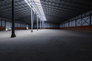 A huge warehouse. Metal construction. Grain dryer. Threshing floor. Blurred-unrecognizable faces of people. Concept theme is the production of food and agricultural production.