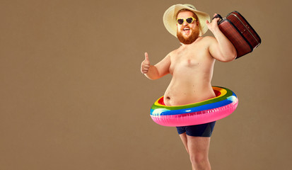 Funny bearded man prepared for beach vacation