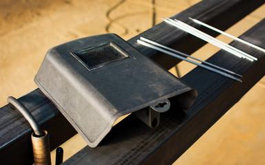 Welding tools on big piece of metal