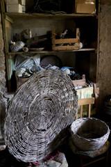 wicker baskets in an old basement of a farm