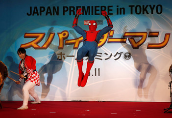 """Performer jumps on the stage during the Japan premiere of """"Spider-Man: Homecoming"""" in Tokyo"""