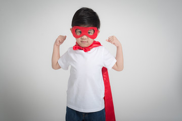 Asian child in in Superhero's costume