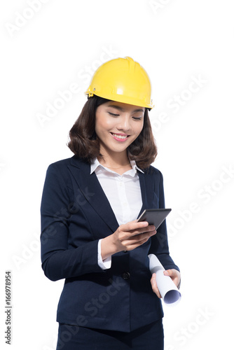 smiling architect woman using smartphone isolated on white fotolia