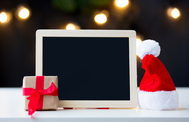 Blackboard and Santa Claus Christmas hat with Fairy Lights