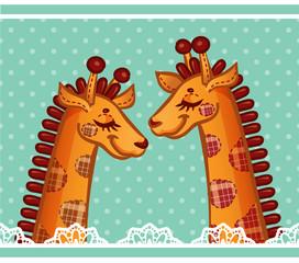 Two cute sleeping giraffes.