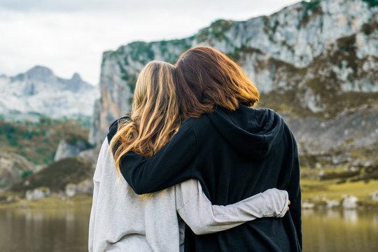 Women standing at lake