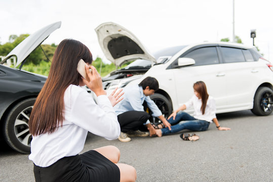 Asia women Stressed Driver Sitting At Roadside After Traffic Accident,wreck,stress,accidents