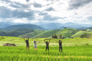 friend hand up and enjoy during travel in natural view of rice farm