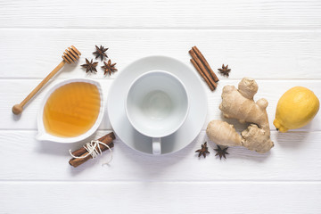 Ingredients for cooking healthy Natural hot beverage. Lemon, honey, Spices and an empty cup
