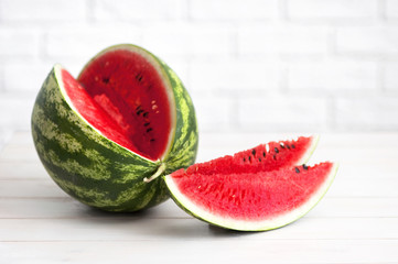 Watermelon on a light rustic wooden background.