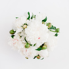 Beautiful white peonies flowers bouquet on white background. Flat lay, top view flower pattern.