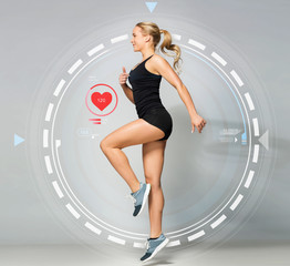 young woman in black sportswear jumping with pulse