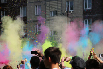 People throw dry colored paint in the air at the festival Holi festival in Gatchina, Russia.