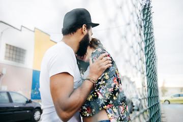 Multiracial couple posing in love