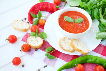 Cold summer tomato dish. Gaspacho soup with toast.