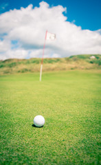 golf ball waiting to be putted