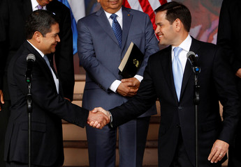 U.S. Senator Rubio shakes hands with Honduras' President Hernandez during a news conference after a private meeting at the presidential palace in Tegucigalpa