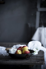 Fresh peaches in a bowl in a rusic kitchen