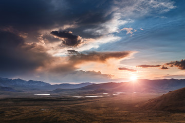 majestic sunset at mountain meadow plateau Eshtikkel, Altai