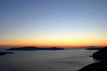 Late Dusk Sunset of Greek Island of Santorini with Ocean and Mountasins