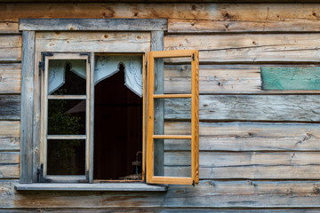 Antique wooden wall and opened window