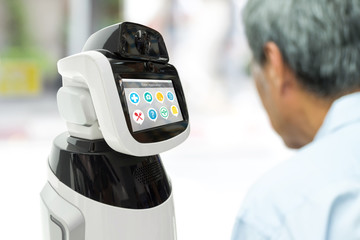 Robot Assistant healthcare helping elder with application. Artificial intelligence (ai) , robot adviser assistant technology concept.