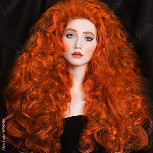 Redhead Woman With Very Long Curly Hair With Unusual