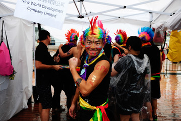 A competitor from the fancy dress competition poses for a picture. Hong Kong celebrates the Dragon Boat Festival with three days of races and parties as part of the 40th anniversary of international dragon boat racing.