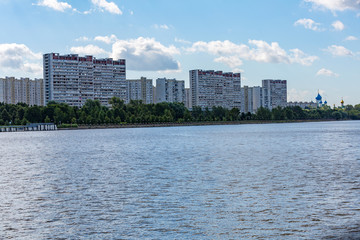 A large multi-storey building on the outskirts of the city. View from the Moscow River