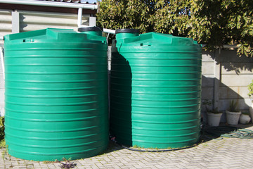 water catchment plastic tanks setup backyard pipes