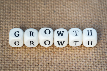 growth word made from toy cubes with letters