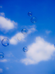 Bubbles against the blue sky in the clouds