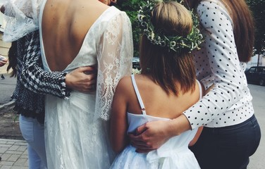 Rear View Of Bride With Friends Standing On Road