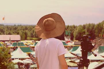 Photographer on fair. Rear view
