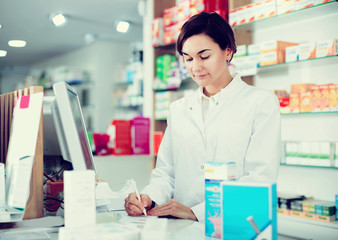 Pharmacist ready to assist in choosing at counter