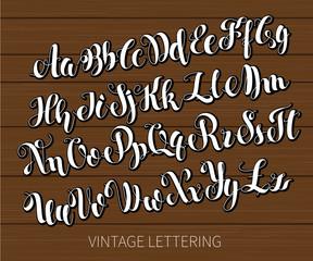 Black and white lettering. ABC Painted Letters. Modern Brushed Lettering. English alphabet. Vector handwritten brush script. Alphabet Education. White letters on chalkboard background.